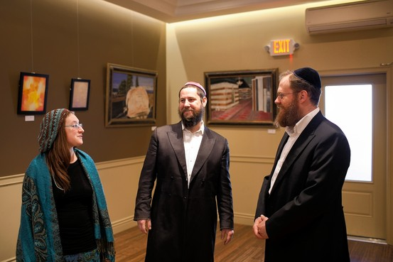 Artist Natalia Kadish, curator Yitzchok Moully and artist Daniel Wolfe Andrew Hinderaker for The Wall Street Journal
