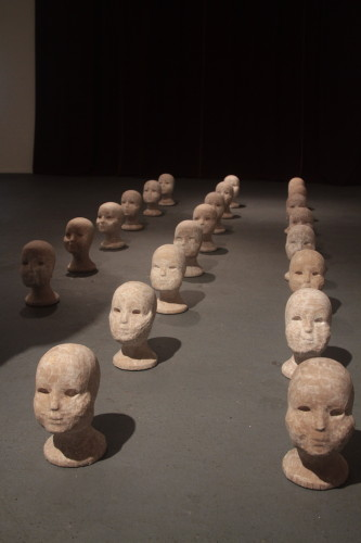 """Kinder"" 2014 Paper mache on wig heads 22 heads representing the Hebrew alphabet Photo by Saul Sudin"